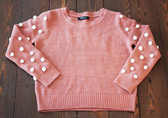 como hacer un jersey con pompones