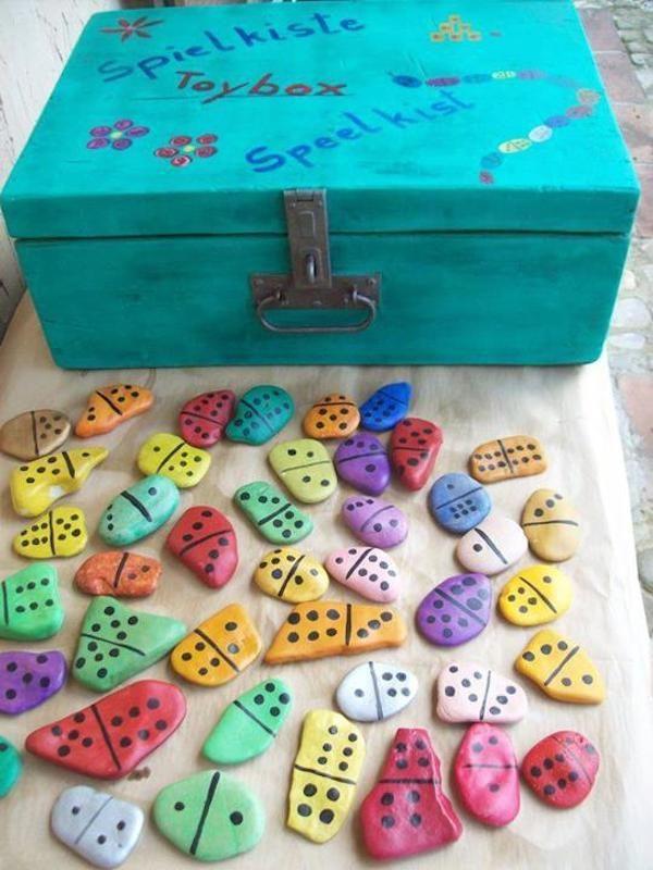 Juegos infantiles con piedras pintadas