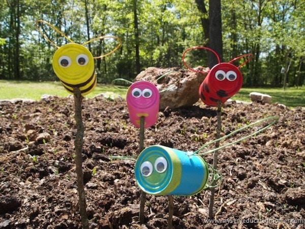 6 manualidades recicladas con latas pequeocio - Decorar jardines con materiales reciclados ...